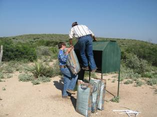manuel-and-willie-emptying-deer-feed-bag.jpg